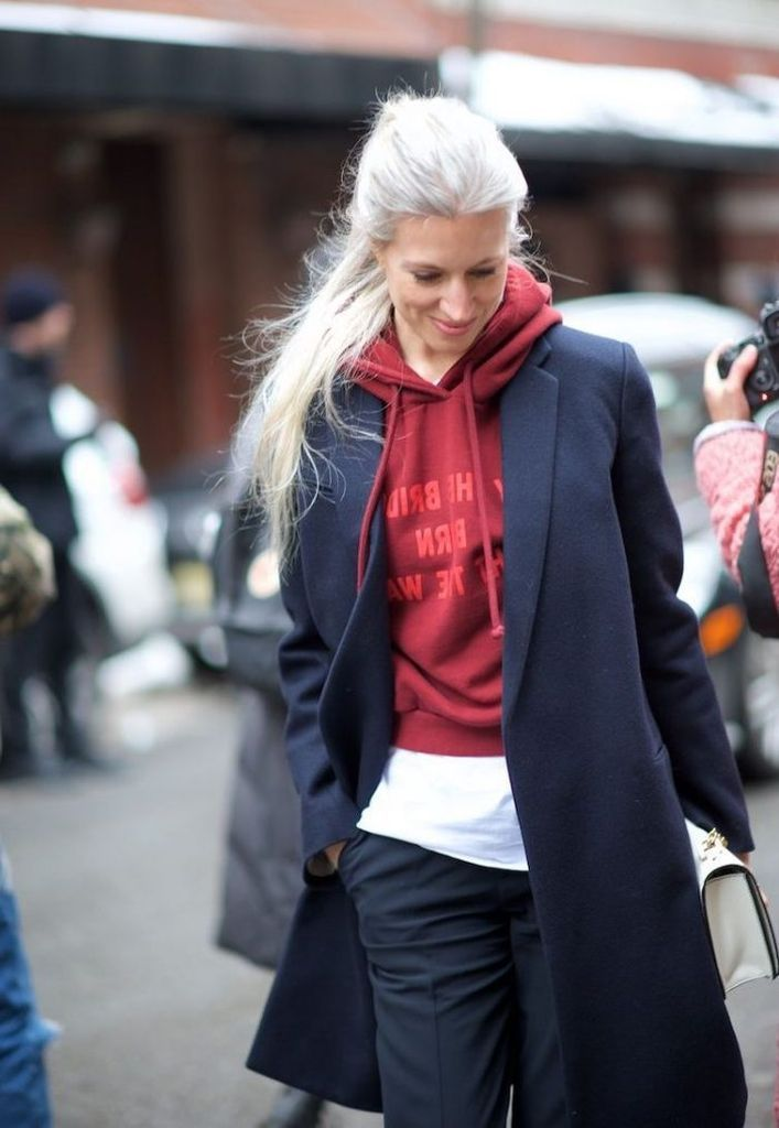 An-incredible-casual-outfit-with-red-hoodie-before-dark-blue-coat-to-perfect-your-style