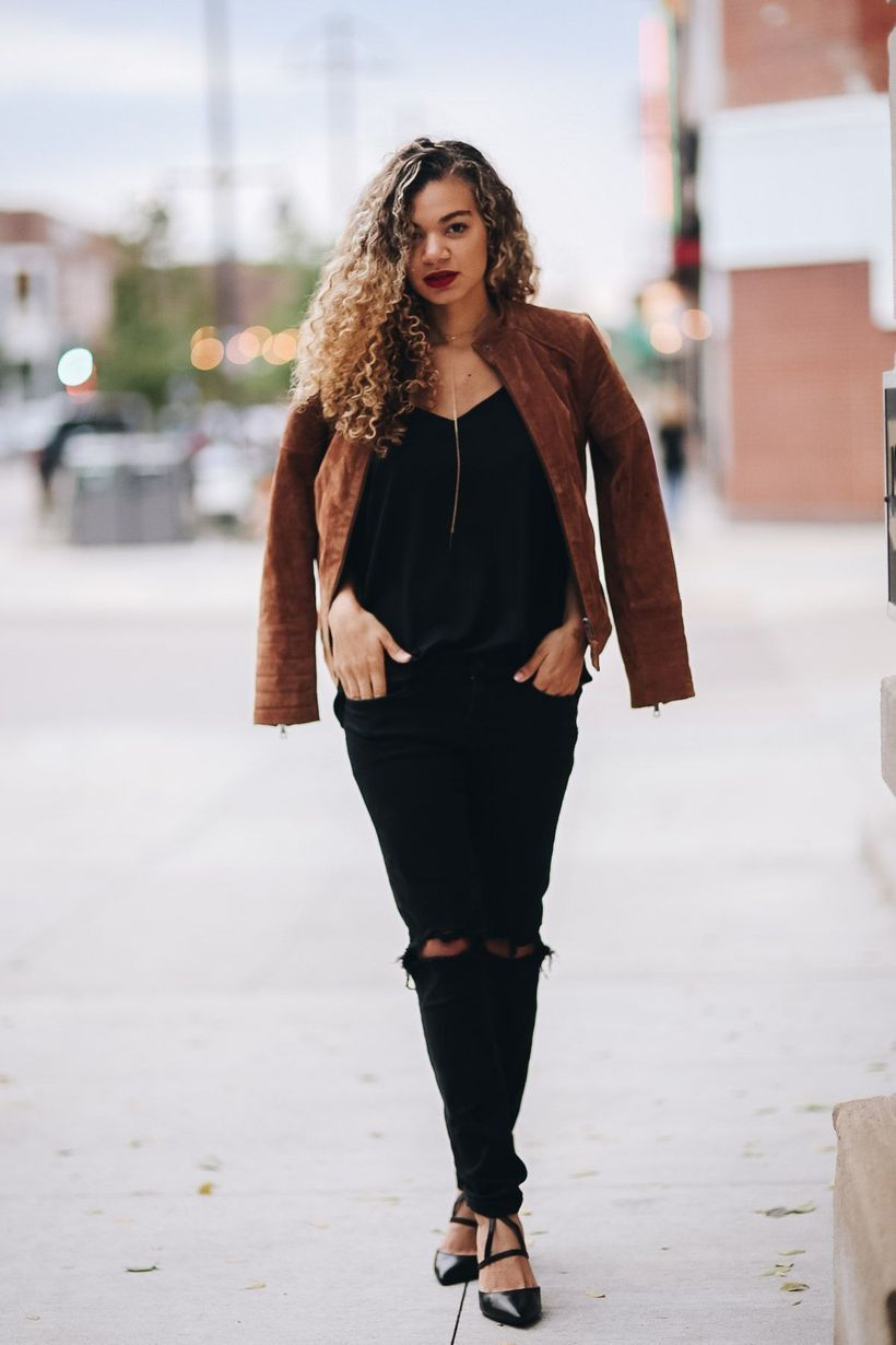 Black outfit and brown jacket