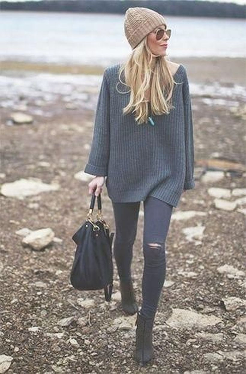 Gray sweater and black ripped pants