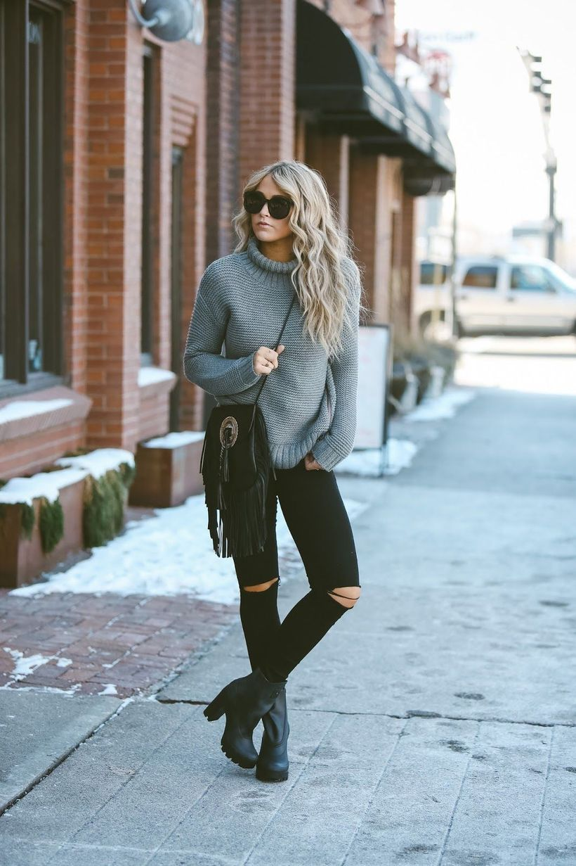 Gray sweater and black ripped jeans