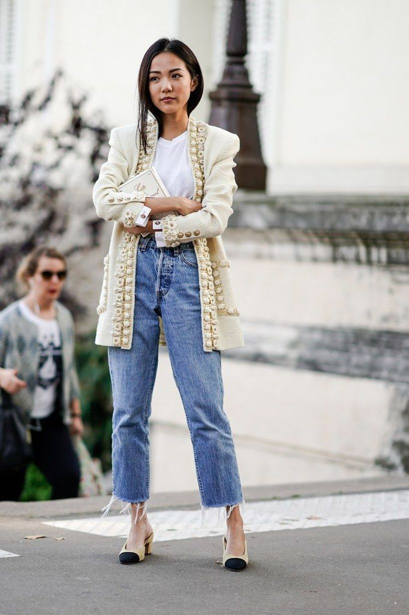 White outer and blue jeans