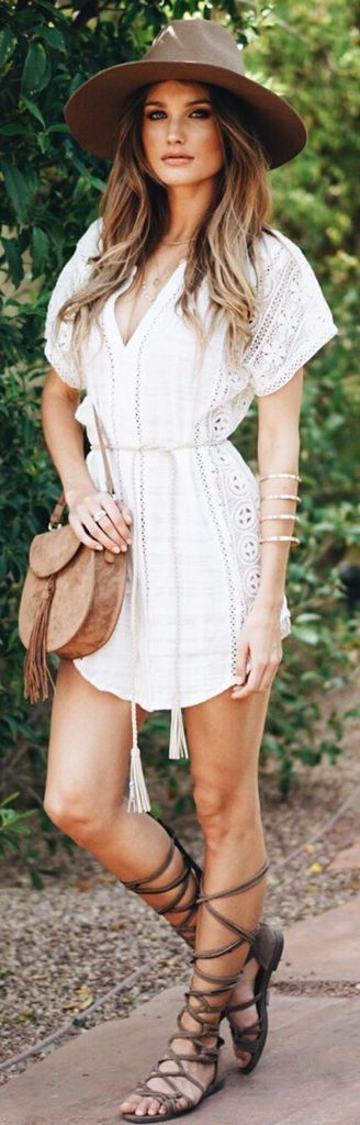 Embroidered dress in white for women combined with leather sling bag