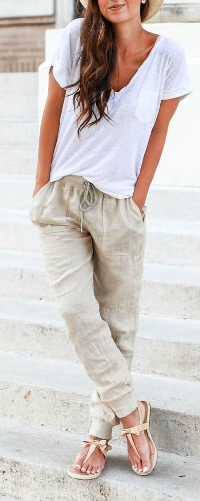 White v-neck t-shirt combined with jogger pants