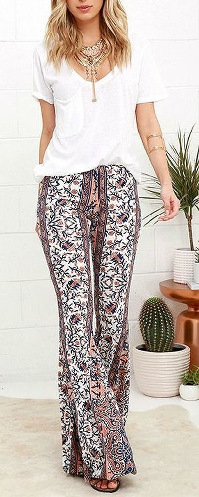 White top combined with width patterned pants