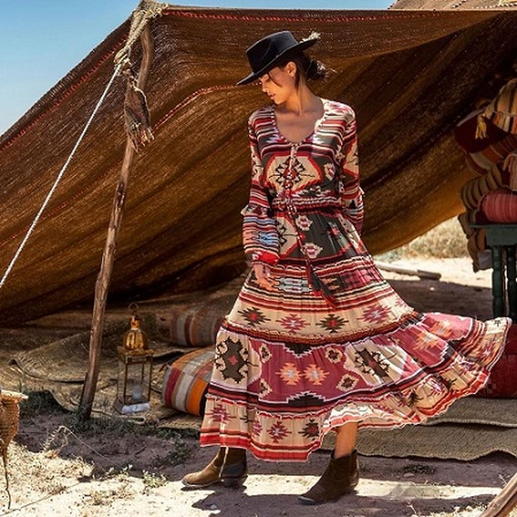 Long dress with bohemian patterned design and short boots