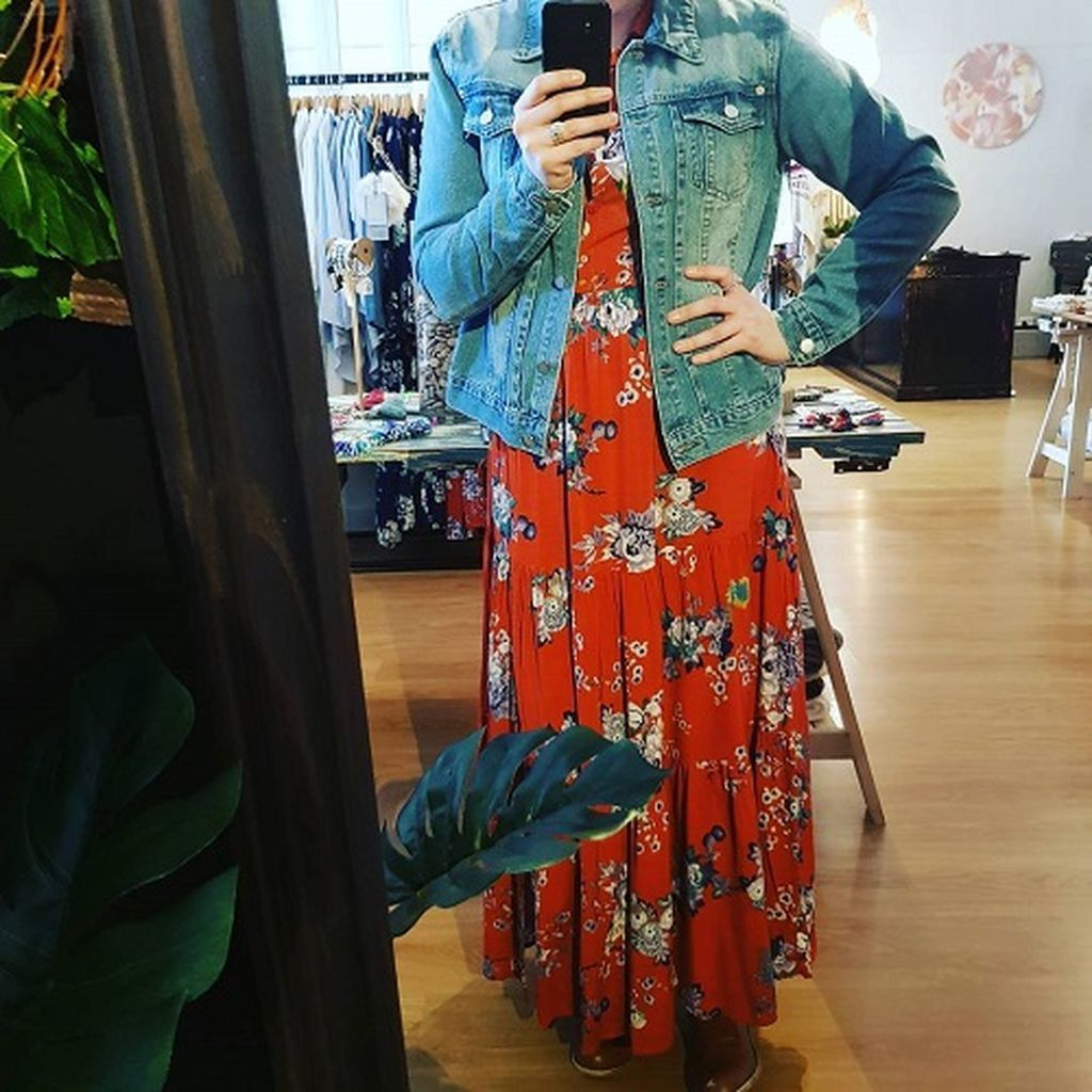 Red floral dress combined with denim jacket