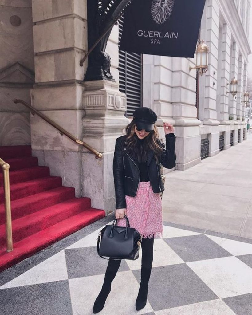 An-attractive-birthday-party-outfit-for-your-special-moment-with-midi-pink-skirt-over-black-trousers-black-leather-jacket-big-black-bag-and-black-shoes-with-pointed-heels.-