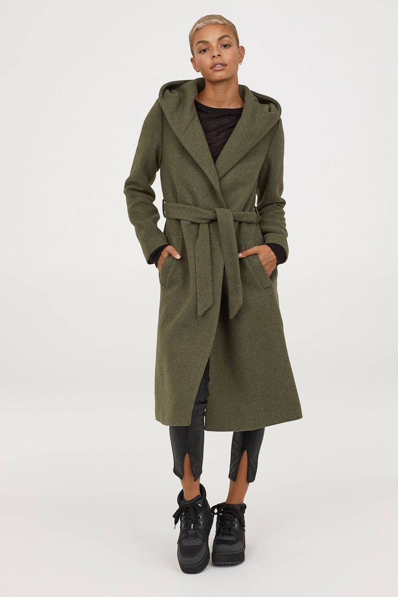 Dark-brown-overcoat-from-warm-wool-with-skullcap-fabric-belts-and-black-legging-for-your-stylish-this-seasons