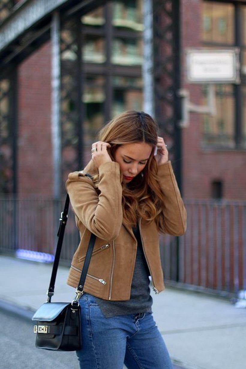 Brown-suede-jacket-with-grey-t-shirt-and-blue-jeans