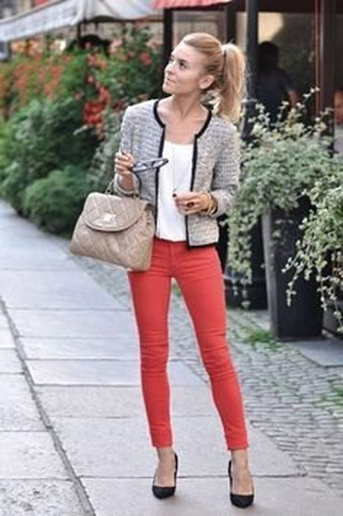 An elegant tweed jacket outfit ideas for women combined with white top & red jeans to beautify your style