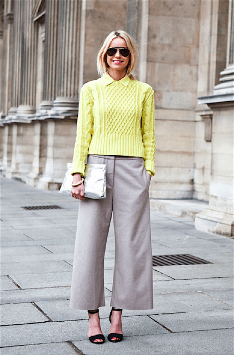 Yellow-cardigan-and-sliver-handbag-with-beige-trousers.